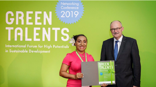 Yalinu Poya receiving her 2019 Green Talents Award for her PhD research into sustainable ammonia synthesis from Dr Michael Meister, Parliament Secretary for the German Government.