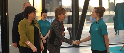 First Minister Nicola Sturgeon shaking hands with Ayrshire College student