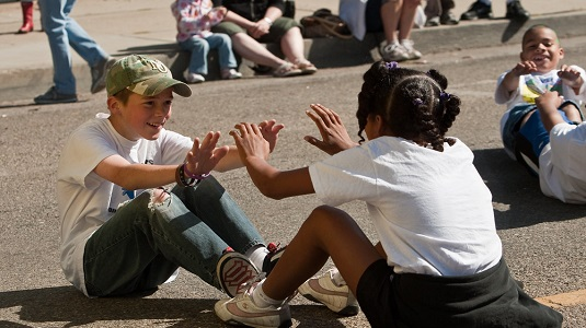 Boy and Girl exhibit friendship in Morro Bay Parade. Photo: Michael 'Mike' L. Bairder.