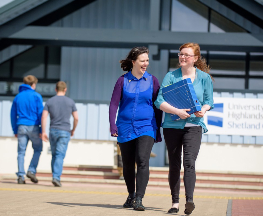 Two students in front of Shetland College