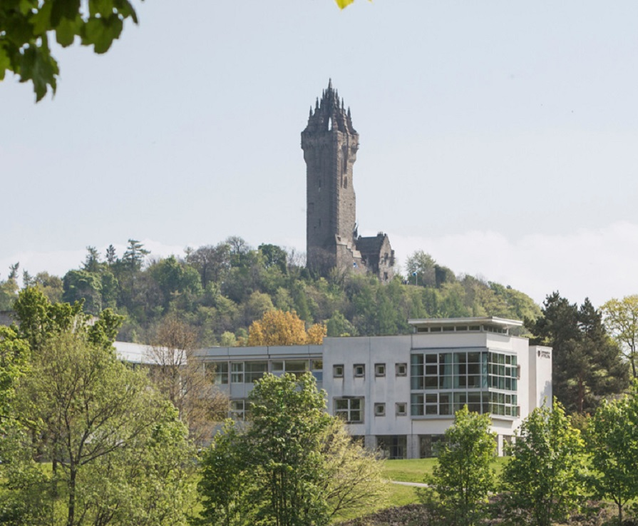 University of Stirling campus with Wallace Monument in background.